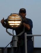 465px-Seaman_send_Morse_code_signals.jpg