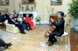 10/6/1987 President Reagan Nancy Reagan Crown Prince Akihito and Crown Princess Michiko listen to Yo-Yo Ma perform in the Yellow Oval Room during a private dinner for Crown Prince Akihito of Japan