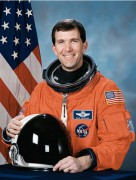454px-Richard_Husband_NASA_photo_portrait_in_orange_suit.jpg