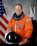 479px-David_M._Brown_NASA_photo_portrait_in_orange_suit.jpg
