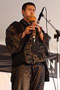 Wang_Li_playing_an_hulusi_calabash_flute_-_2012_Richmond_Folk_Festival.jpg